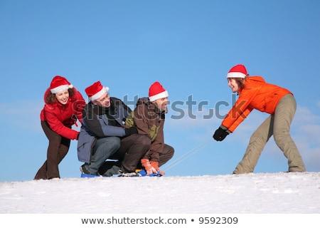 Eine Frau ziehen zwei Männer andere Frau Stock foto © Paha_L