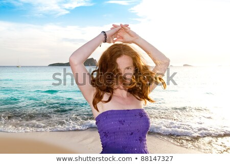 Ibiza girl at sunset in Cala Conta San Antonio Stock photo © lunamarina