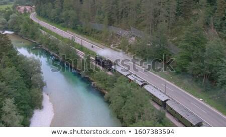 steam train powers along railway stock photo © backyardproductions