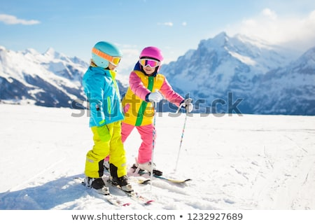 Boy and Girl Skiing  stock photo © mintymilk