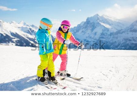 Menino menina esqui céu esportes criança Foto stock © mintymilk