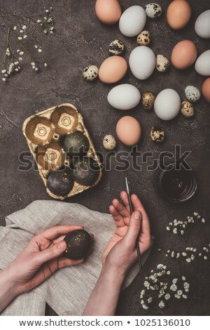 Golden Egg in a man's hand with flower Stock photo © g215