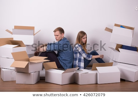 Couple surrounded by packing boxes Stock photo © photography33