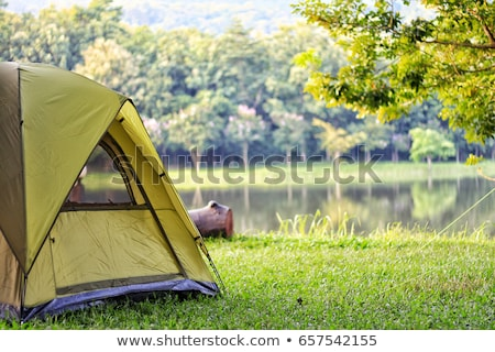 Camping tenda em pé maçã jardim nuvens Foto stock © vrvalerian
