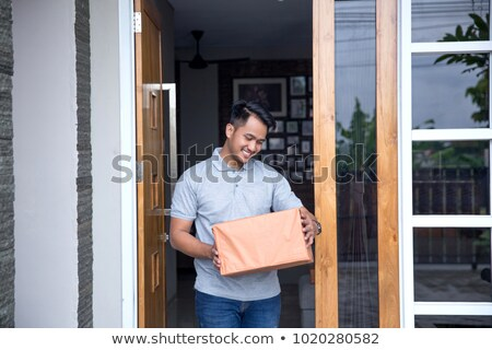 Man signing for a parcel at the front door Stock photo © photography33