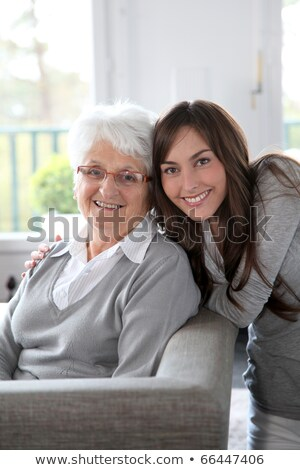 young woman helping senior lady with the housework Stock photo © photography33