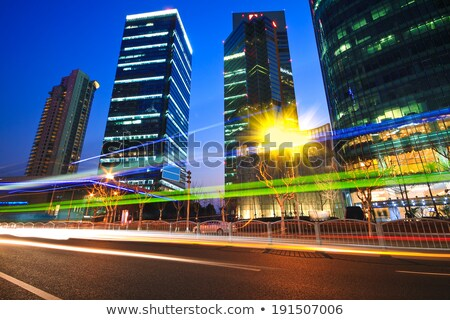 modern office building ray background night in shanghai stock photo © artphoto
