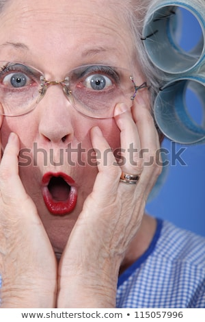 Shocked old lady wearing hair rollers Stock photo © photography33