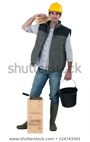 Bricklayer carrying bucket Stock photo © photography33