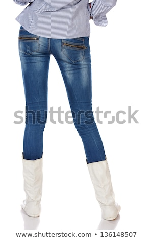 Female ass dressed in jeans on black Stock photo © pzaxe