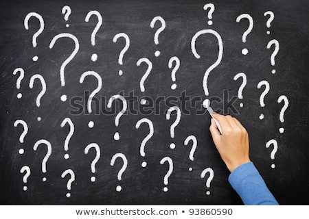 question marks on chalkboard decision confusion faq or other concept hand writing with chalk on stock photo © bbbar