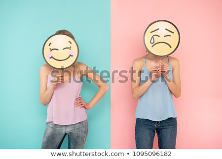 The sad girl with a cheerful mask Stock photo © nik187