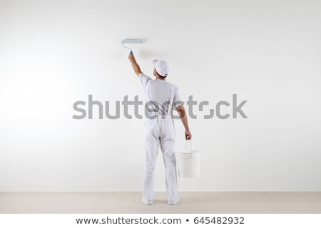 man painting wall with roller stock photo © photography33