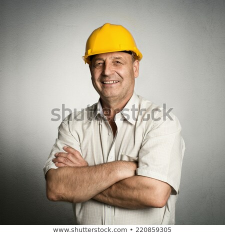 smiling senior construction engineer stock photo © stockyimages