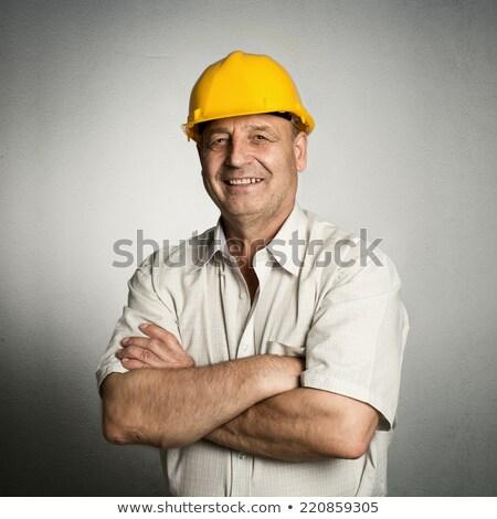 Glimlachend senior bouw ingenieur schrijven documenten Stockfoto © stockyimages