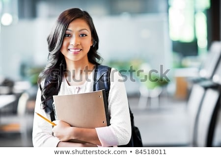 in the library   pretty female student with books stock photo © lightpoet