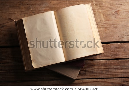 old books open on wooden table stock photo © sandralise