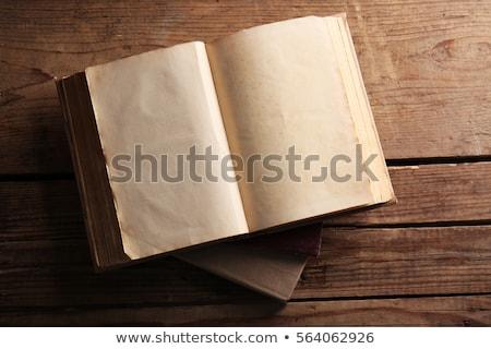 ストックフォト: Old Books Open On Wooden Table