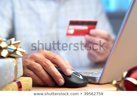 Stock photo: Computer mouse with gold ribboned gifts for online shopping