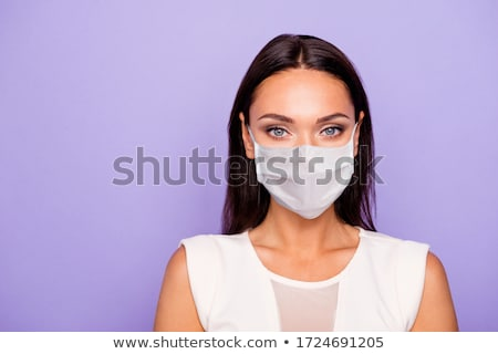 Beautiful woman wearing white dress Stock photo © konradbak