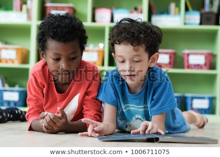 young student reading book stock photo © lithian