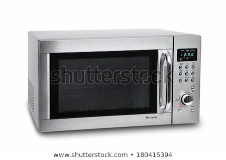 Microonda forno branco preto fogão fechar Foto stock © ozaiachin