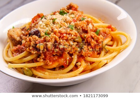 pasta with minced meat capers and parmesan cheese stock photo © deymos