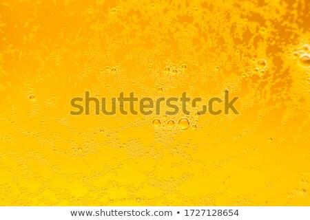 cerveja · espuma · luz · brilhante · bolha · líquido - foto stock © silvek