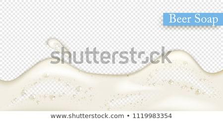 Birra schiuma macro shot top vetro Foto d'archivio © Gordo25