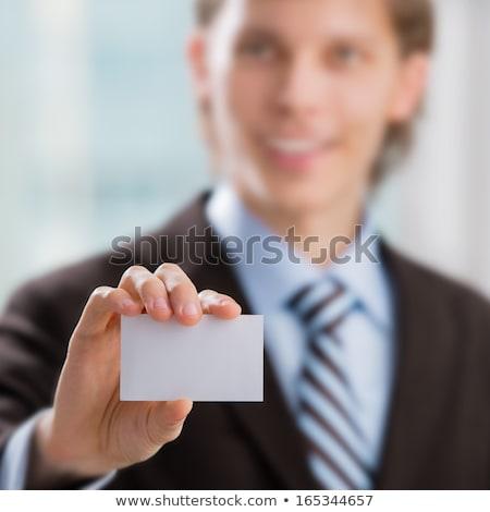 zakenman · visitekaartje · binnenshuis · kantoor · hand - stockfoto © HASLOO