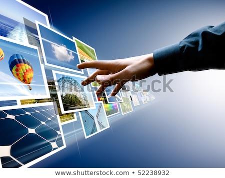 Immagini in streaming uomo d'affari toccare grigio mano Foto d'archivio © matteobragaglio