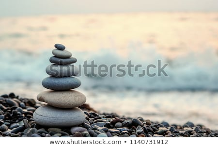 Stock photo: Zen stones hand