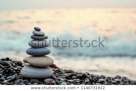 kövek · kéz · sötét · kék · ég · üzlet · égbolt - stock fotó © tony4urban