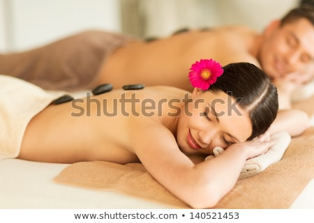 Attractive Young Couple Lying on Rocks stock photo © iofoto