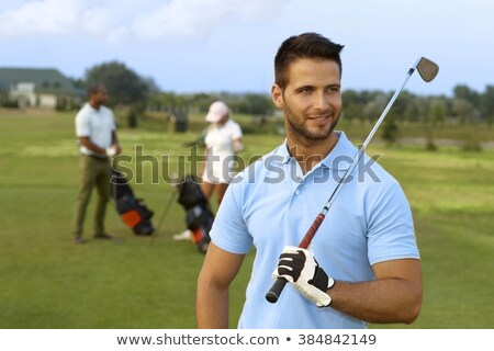 close up of man holding golf stick stock photo © zzve