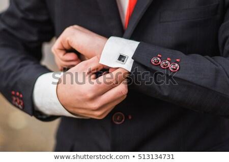 Férfi mandzsettagombok mosolyog üzletember visel hivatalos Stock fotó © stepstock