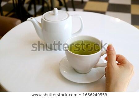 közelkép · kezek · tart · teáscsésze · csészealj · elegáns - stock fotó © sarahdoow