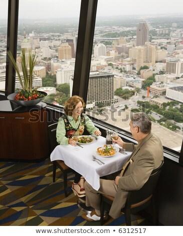 Mature couple eating romantic dinner in a fancy restaurant Stock photo © Kzenon