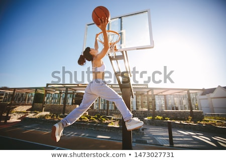 woman playing with basketball Stock photo © chesterf