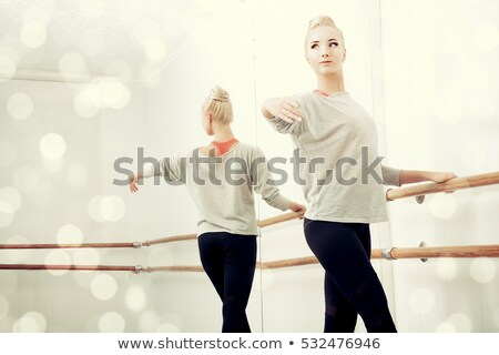 Sepia toned portrait of a beautiful dancing blond girl Stock photo © Nejron