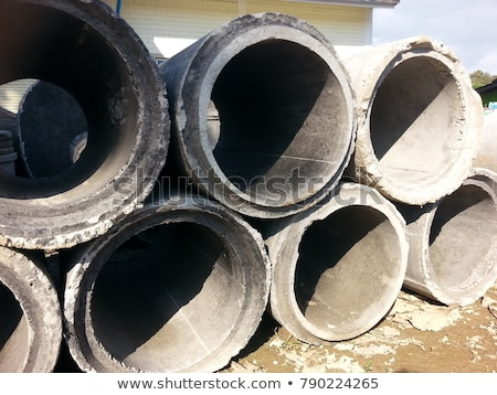 Several pipes stacked in yard Stock photo © juniart