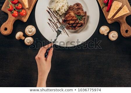 Mulher alimentação comestível cogumelo topo ver Foto stock © stevanovicigor