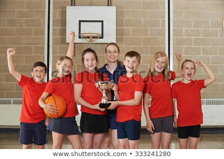 Female School Sports Team In Gym With Trophy Stock photo © HighwayStarz
