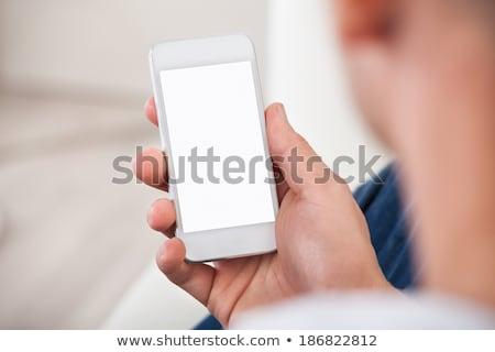Váll kilátás képernyő okostelefon mobiltelefon férfi Stock fotó © AndreyPopov