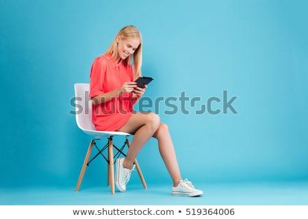 jovem · loiro · mulher · câmera · sério - foto stock © juniart