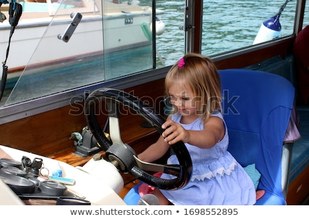 cheerful captain behind wheel stock photo © anna_om