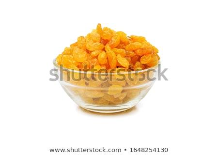 Dried raisins on a white background Stock photo © ozaiachin