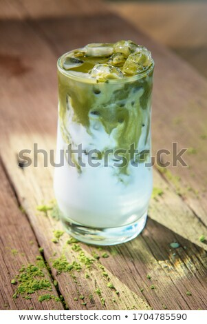 Glass of green tea latte frappe Stock photo © nalinratphi