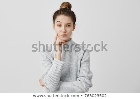 Sceptical woman with raised eyebrows Stock photo © ozgur