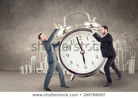 Unsmiling businessman showing something with his hand Stock photo © wavebreak_media
